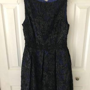 Isaac Mizrahi black lace dress.